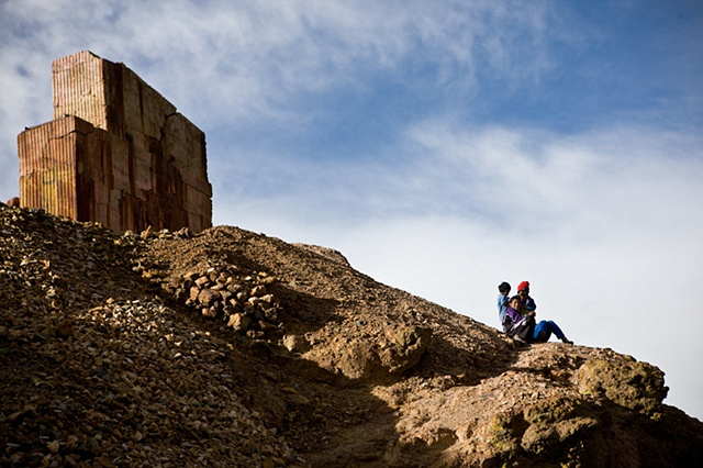 "Children at the edge of a cliff close to the ""bocamina"" (an entrance to a mine) they guard together with their mother."