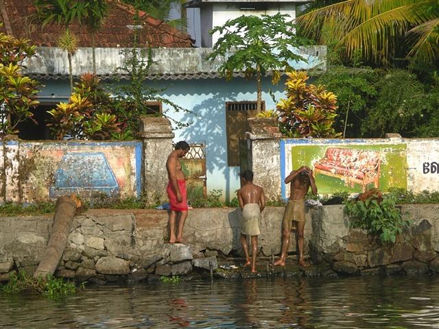 Three Men Bathing, Kerala, India.
