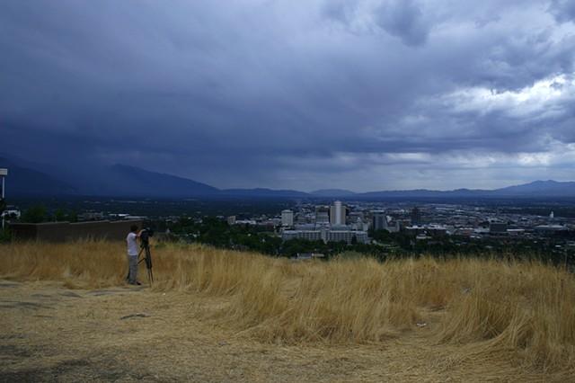 A news cameraman films a storm as it sweeps across Utah's Salt Lake Valley.