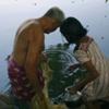 Grandfather and his Granddaughter Fishing, Kerala, India.