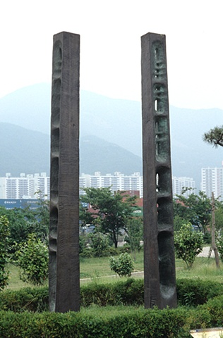Public art, carved wood cast in bronze with Morse Code text, Pusan, South Korea