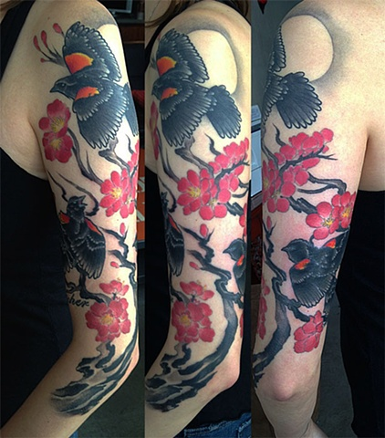 Red Wing Blackbird and cherry blossoms tattoo by Adam Sky, San Francisco, California