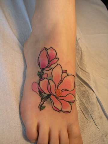 Magnolia tattoo on foot by Custom tattoos by Adam Sky, San Francisco, California