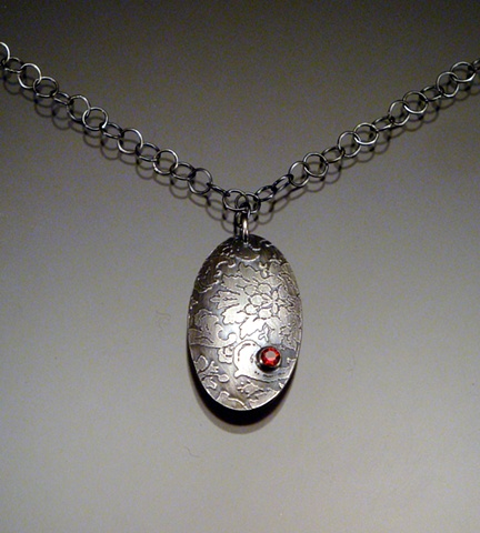 Etched Oval Necklace with Garnet, oxidized
