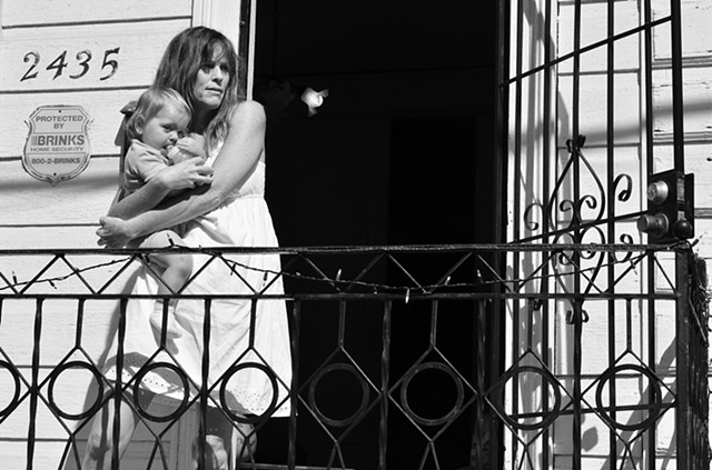 Mother and child on porch, Bywater - New Orleans