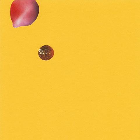 paper lure (pink/orange blobs/jewel on yellow)