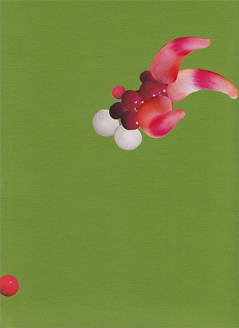 paper lure (red/white spheres and pink tentacles on green)