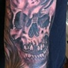 Black and grey skull and smoke on Metal Bobby