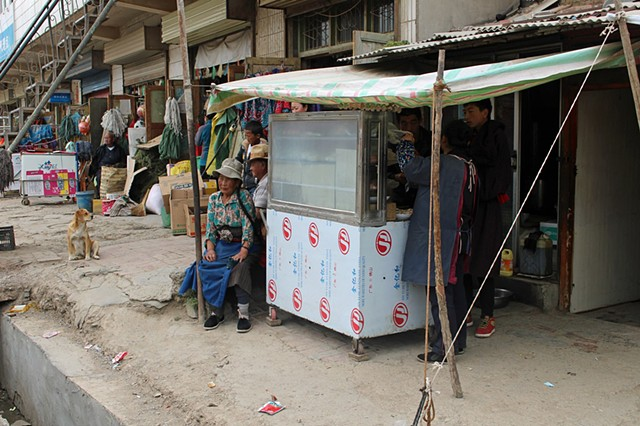 Icecream venders and apartments outside the temple grounds in Labrang