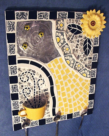 miexed media mosaic wall hanging from recycled dishes with half cup pocket for storage and magenetic board for messages. sunflower, black and white.
