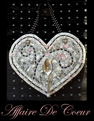 heart shaped mosaic wall hanging with recycled spoon hook for keeping rings or hanging lingerie. recycled china in pink, white, black with polka dot hanging ribbon.