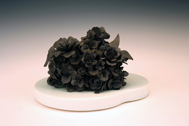 black clay floral scupture