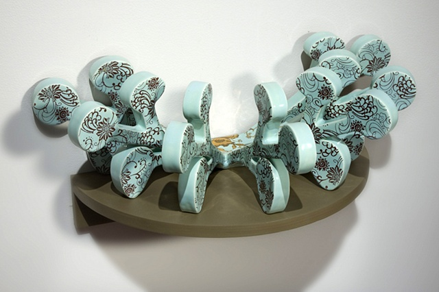 Pale green blue porcelain wall hung sculpture with decals