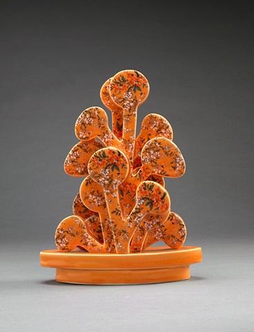 Orange porcelain tree sculpture with vintage decals