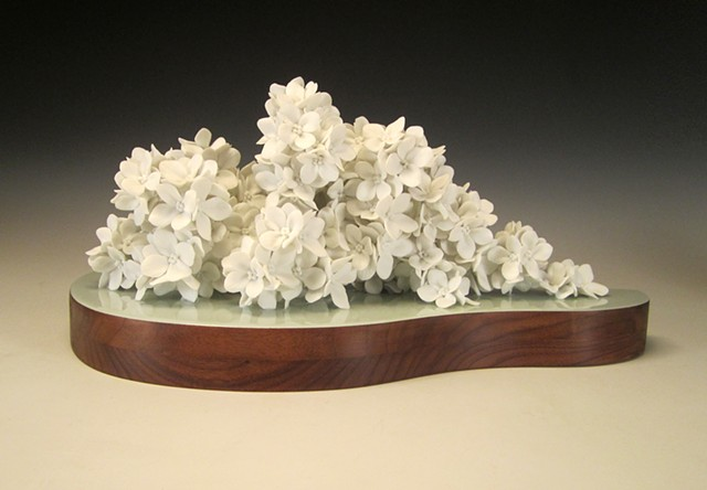 This wall hanging landscape sculpture is made of hand-formed porcelain flowers and vintage walnut.