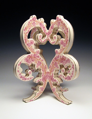 Pink, white and gold porcelain sculpture with vintage decals