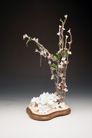 hand built white porcelain flower and ice storm flower sculpture on a walnut base