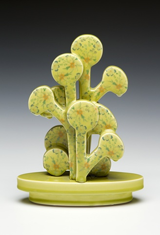 Chartreuse porcelain tree sculpture with vintage decals