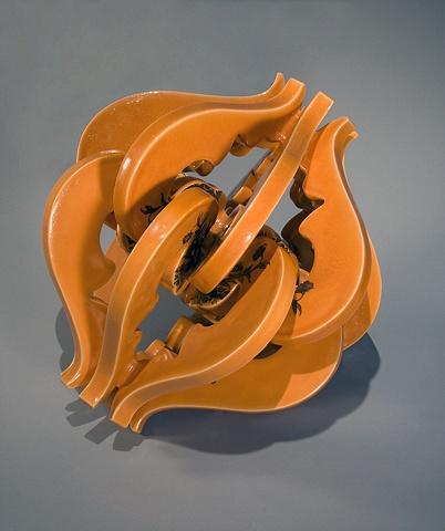Orange porcelain sculpture with vintage decals